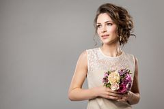 Fashion Models Beauty Portrait with Flowers Bouquet, Beautiful Woman Bridal Makeup and Hairstyle, Girl studio shot on gray