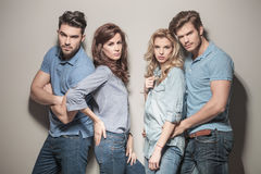 Fashion models in blue jeans and  polo shirts Stock Images