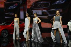 Fashion models in the booth of Infiniti. Guangzhou, China - November 18, 2017: Fashion models were in the booth of Infiniti in the 15th China Guangzhou Stock Images