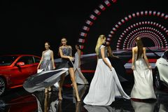 Fashion models in the booth of Infiniti. Guangzhou, China - November 18, 2017: Fashion models were in the booth of Infiniti in the 15th China Guangzhou Stock Photography