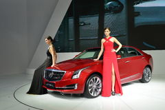 Fashion Models on Cadillac ATS-L saloon car Royalty Free Stock Images