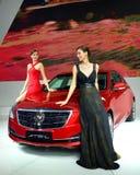 Fashion Models on Cadillac ATS-L saloon car Stock Photo