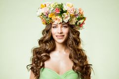 Fashion Models Flowers Wreath Beauty Portrait, Woman Makeup with Rose Flower in Hairstyle, Beautiful Girl. Studio shot on green background royalty free stock photography