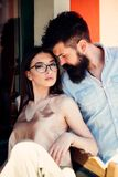 Fashion models. Girlfriend and boyfriend in relations of friendship. Couple in love. Couple of lovers with fashion style. Sensual women and bearded men in love royalty free stock photo