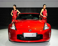 Fashion Models on NISSAN 370Z saloon car Royalty Free Stock Image
