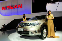 Fashion Models on NISSAN Murano SUV Stock Images