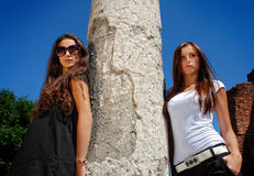 Fashion models posing near ruin. Stock Image