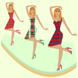 Fashion models posing on podium in various checker Royalty Free Stock Photo