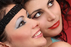Fashion models with toothy smiles. Fashion models with stage makeup and toothy smiles close-up Stock Images