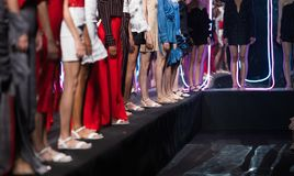Fashion Models walk back Finale on Runway Ramp during Fashion Week. Woman Fashion Models stand Finale on Runway Ramp during Fashion Week to present New Clothing royalty free stock photos