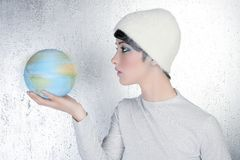 Fashion modern silver woman holding global map Royalty Free Stock Image