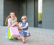 Fashion-monger baby on shopping with mom. Wear new glasses royalty free stock photos