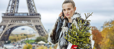 Fashion-monger with Christmas tree talking on cell phone, Paris Stock Photos