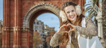 Fashion-monger near Arc de Triomf showing heart shaped hands Royalty Free Stock Photography