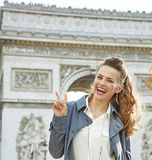 Fashion-monger near Arc de Triomphe showing victory gesture Royalty Free Stock Photos