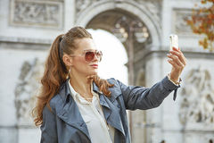 Fashion-monger in Paris, France taking selfie with phone Royalty Free Stock Image