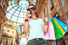 Fashion monger with shopping bags and coffee cup in Galleria Stock Photos