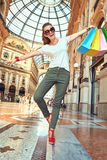 Fashion monger with shopping bags having fun time in Galleria Stock Image