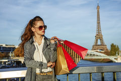 Fashion-monger with shopping bags looking aside. Paris, France Stock Photos