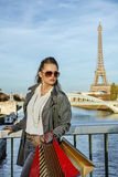 Fashion-monger with shopping bags in Paris, France looking aside Stock Photography