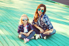 Fashion mother and child daughter wearing a sunglasses Stock Image