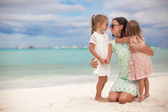 Fashion mother and two her adorable daughters at Stock Photos