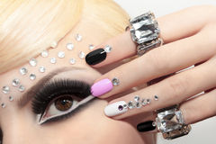 Fashion nails and makeup. Royalty Free Stock Photos