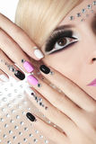 Fashion nails and makeup with rhinestones. Royalty Free Stock Photo