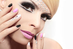 Fashion nails and makeup with rhinestones. Royalty Free Stock Photography