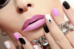 Fashion nails with rhinestones. Fashion nails with rhinestones and colored nail Polish Royalty Free Stock Image