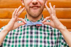 Fashion nerd correcting his bowtie Stock Image