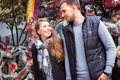 Fashion of nice pretty young hipster woman with a handsome man look at each other and holding hands Royalty Free Stock Images