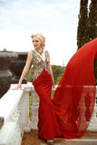 Fashion outdoor photo of beautiful sexy woman in gorgeous mermai Royalty Free Stock Images