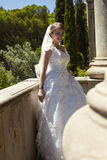 Fashion outdoor photo of gorgeous bride in luxurious wedding dress Royalty Free Stock Photos