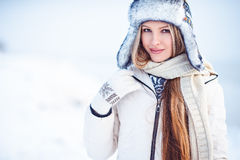 Fashion outdoor photo of gorgeous woman with long blonde hair wears luxurious white coat Royalty Free Stock Photos