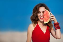 Fashion outdoor photo of a sensual beautiful woman with red stock images