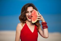 Fashion outdoor photo of a sensual beautiful woman with red royalty free stock image