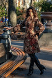 Fashion outdoor photo of sexy glamour woman posing in autumn park. Royalty Free Stock Images