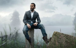 Fashion outdoor photo of stylish handsome man Stock Photos