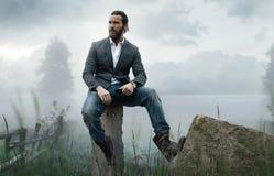 Fashion outdoor photo of stylish handsome man Stock Photos