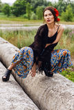 Fashion outdoor portrait of a beautiful brunette woman Royalty Free Stock Photos