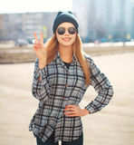 Fashion outdoor portrait of pretty cool girl having fun Royalty Free Stock Image
