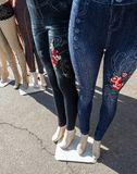 Fashion pants. Boutique jeans and leggings on the sidewalk Stock Images