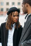 Fashion pedestrian couple. African American youth. Young stylish people, unrecognizable male, beauty concept Stock Photo