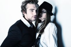 Fashion people. Shot of a passionate young people in love. Isolated over white Royalty Free Stock Photo