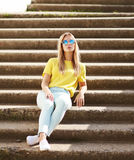 Fashion and people concept - lifestyle portrait stylish girl Royalty Free Stock Photography
