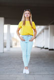 Fashion and people concept - stylish sensual pretty woman posing. Outdoors in city Stock Photos