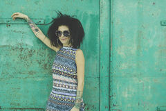 Fashion photo with afro hairstyle. Laughing African young woman with an afro hairstyle wearing sunglasses and pastel stylization Stock Images