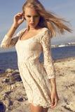 Fashion photo of beautiful blond girl posing on beach Stock Photos