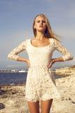 Fashion photo of beautiful blond girl posing on beach Stock Image